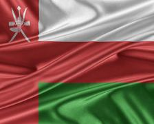 Oman flag with a glossy silk texture. Stock Illustration