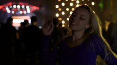 Cute blonde woman dancing at music festival, enjoying active night life Stock Footage