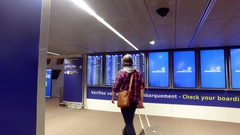 People consulting timetable at Charles De Gaulle Airport Stock Footage
