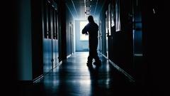 Lab worker is dancing in the corridor. Stock Footage