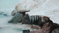Nature and landscape of Azov sea. Stones covered with ice, and cold waves of the Stock Footage