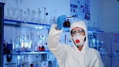Lab worker examines a test tube. Stock Footage