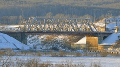 The train goes through railway bridge. Winter landscape Stock Footage