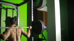 Young man doing deadlift exercise at gym. barbell Stock Footage