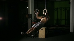 Gymnast competing on rings. street workout, CrossFit. training in the gym Stock Footage