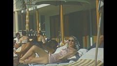 Vintage 16mm film, 1956, Jamaica Montego Bay resort, ladies lounging by the pool Stock Footage