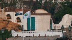 Egypt Flags fluttering in Mast on the Background of Resort Hotels Stock Footage