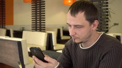 Man Chatting Google Maps By Mobile Cell Phone At The Table Fast Food Cafe Stock Footage