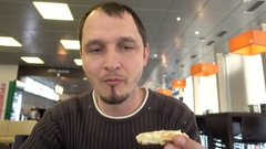 Young, Handsome Man Eating Lunch In Road Cafe Stock Footage