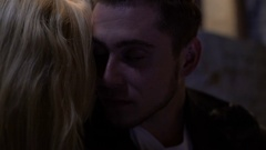 Tender man talking to girlfriend at nightclub, close-up of faces, relationship Stock Footage