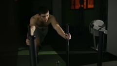 Man performs gym exercises. pushing the platform in front of him, powerlifting Stock Footage