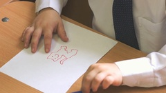 Child draws the picture using a felt pen. Close-up Stock Footage
