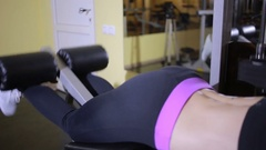 Girl athlete doing exercises on the simulator in the gym Stock Footage
