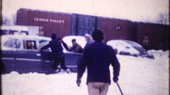 Men gather to push cars stuck in the snow, 3871 vintage film home movie Stock Footage