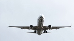 Commercial Airplane Flying Overhead Arrival Or Departure Stock Footage