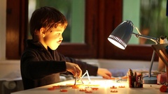 Young boys figuring out concetual puzzle when suddenly lamps is turned. Stock Footage