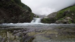 Small cascade on mountain river Stock Footage