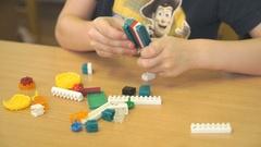 Preschool boy collecting the designer in a nursery Stock Footage