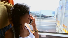 Young Happy Woman With Smart Phone on the Bus Stock Footage