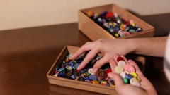 A lot of colorful buttons in a wooden box. Stock Footage