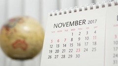 Motion of November 2017 calendar with blur earth globe turning background Stock Footage