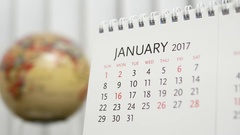 Motion of January 2017 calendar with blur earth globe turning background Stock Footage