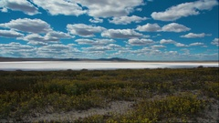 Time lapse clouds travel over Soda Lake salt flats. HD stock footage. Stock Footage