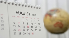 Motion of August 2017 calendar with blur earth globe turning background Stock Footage