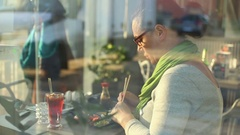 Woman eating a meal in a restaurant sushi Stock Footage