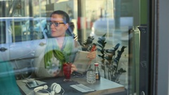Woman paying by credit card for food in a restaurant Stock Footage
