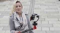 Selfie girl taking video for web blog - top angle looking down Stock Footage