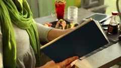 Women reading a book in the cafe  Stock Footage