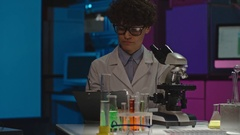 Female Scientist with Microscope in Lab Stock Footage
