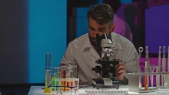 Scientist Working with Microscope in Lab Stock Footage