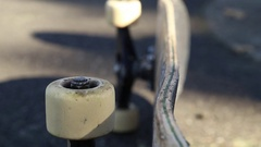 A skateboard laying sideways on the street. Stock Footage