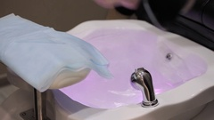 Girl in a beauty salon doing a pedicure Stock Footage