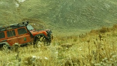 Man Driving 4x4 Off-Road  on Mountain Peak Stock Footage