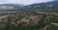 Aerial of a ancient small village on loess plateau, Shanxi China Stock Footage