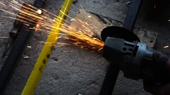 Worker cutting a metal pipe. slow motion shot Stock Footage