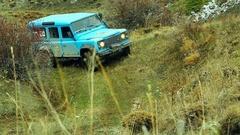 Off-Road Vehicle on Mountain Peak Stock Footage