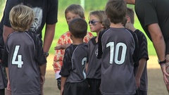 Boys ages 6 to 8 playing in a youth soccer league game, slow motion. Arkistovideo
