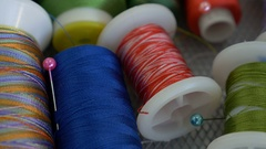 4K : Dolly shot of colorful spools of thread in textile factory Stock Footage