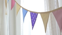4K : Dolly shot of colorful party flags bunting hanging on the wall Stock Footage
