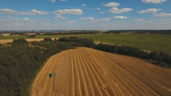 Aerial view combine harvesting a field of wheat Stock Footage