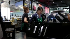 Motion of barista making coffee for customer at Starbucks store Stock Footage