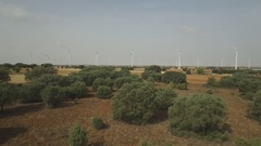 Going away from wind turbines aerial view, 4k Stock Footage