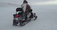 A young traveler driving a snowmobile over a lake in Yamal. Expedition 2016 Stock Footage