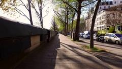 Walking down Parisian street near Notre Dame Stock Footage