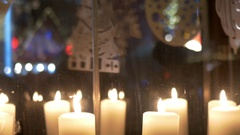 Advent white candles over that revolve decorations made of plywood dep Stock Footage