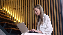 Teen girl with portable laptop for online communication Stock Footage